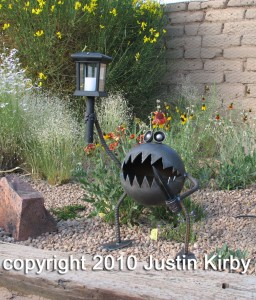 Metal gremlin with solar light